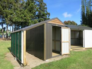 garden shed with green house on side